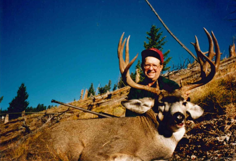 Jack with a mule deer buck